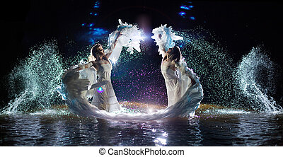 Beautiful white angels are dancing in the water drops