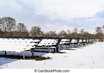 Solar panel field with snow