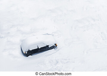 Car Trapped in Deep Snow Build-up after a Blizzard or Big...