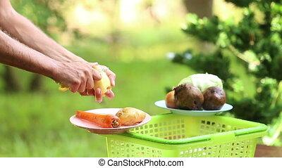 cooking ukrainian national soup borsch - man hands peels...