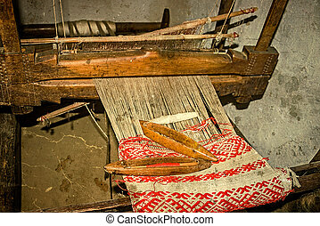 Old photo at one romanian farmhouse interior,with loom...