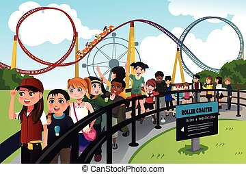 Children waiting in line for a roller coaster ride - A...