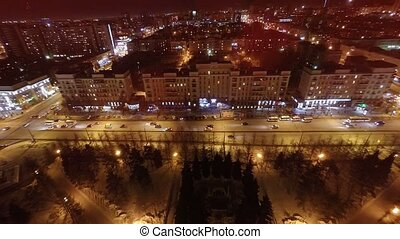 Flying over the city at night. - Shooting with quadrocopter...
