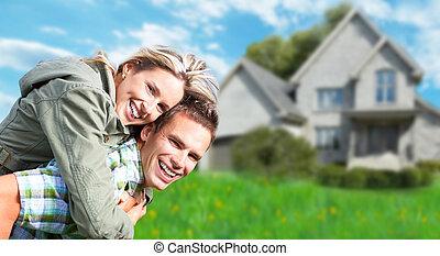 Couple near new house.