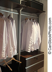 Mens shirts wardrobe - Mens white business shirts organized...