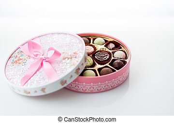 Chocolates in pink box on white background - Pink box of...