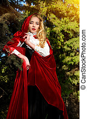 forest of magic - Beautiful blonde woman in old-fashioned...