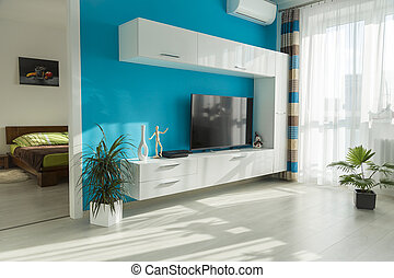 sunny living room - Modern sunny living room with TV and...