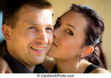 Portrait of a happy couple with vigneted dark corners and...