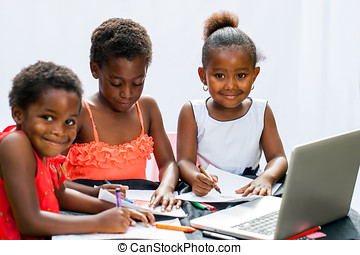 Three African fiends spending time together drawing -...