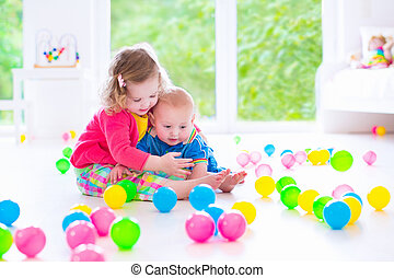Children playing at day care - Two happy little children,...