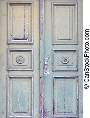 Old rustic light green wooden door