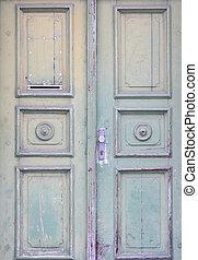 Old rustic light green wooden door