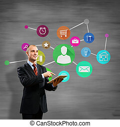 User interface - Businessman using tablet pc and color icons...