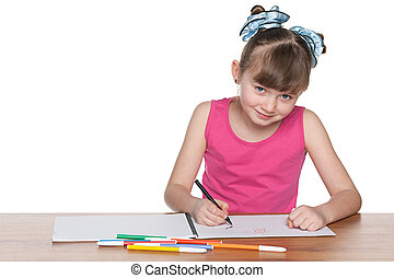 Clever school girl at the desk