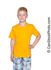 Red-haired boy stands on the white background - A red-haired...