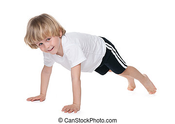 Cute boy performs gymnastic exercises