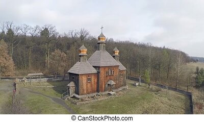 Aerial view of the mysterious church, in a thick dark forest...
