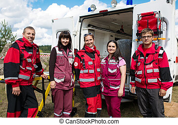 Group of smiling paramedics - medicine, profession, teamwork...