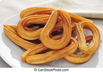churros typical of Spain - closeup of a plate with some...