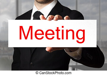 businessman in office holding sign meeting - businessman in...