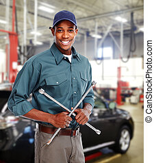 Mechanic with wrench in garage. Car repair service