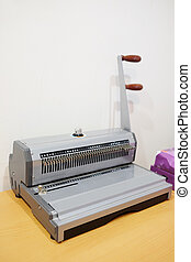 bookbinding machine - The image of a bookbinding machine...
