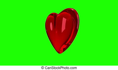 Red glossy 3D heart rotates 360 on green-screen. Seamless