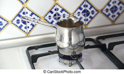 On the gas stove to boil coffee in a Turkish coffee maker