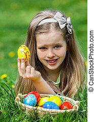Child find easter egg outdoor - Happy child find easter egg...