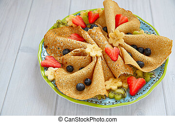 Funny butterfly shaped crepes with berries for kids