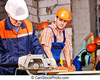 Group people builder with circular saw - Happy group people...