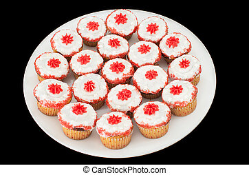 A dish full of cup cakes against black background