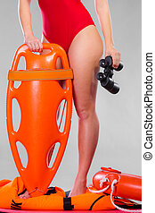 lifeguard on duty holds binocular - Accident prevention and...