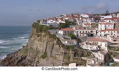 Village on top of steep cliff, Atlantic coast at Boca do...