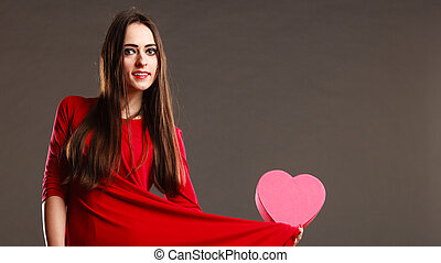 Woman red dress holds heart shaped box - Valentines day,...