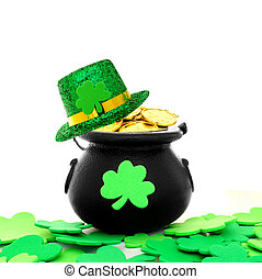 St Patricks Day pot of gold with shamrocks and hat over...