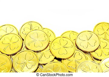 St Patricks Day gold coin border over a white background