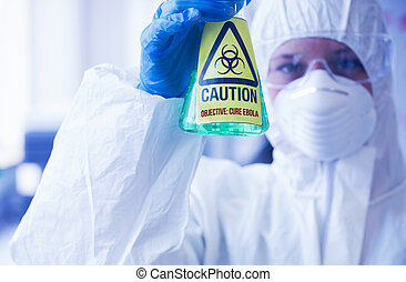 Scientist in protective suit holding beaker with caution...
