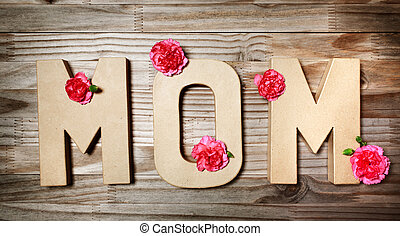 MOM text in big cardboard letters with flowers