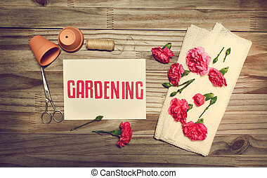 Gardening theme with flowerpots, scissors, and carnation flowers