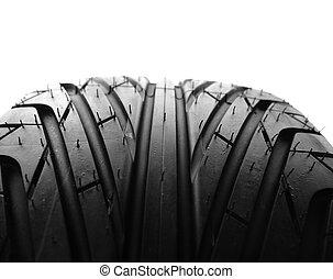 Tire tread - Closeup of tire tread, plain background