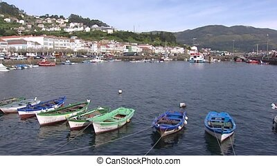 Hold + pan - small fishing boats in Muros harbor at Atlantic...