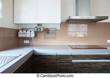 Kitchen with induction hob - Horizontal view of kitchen with...