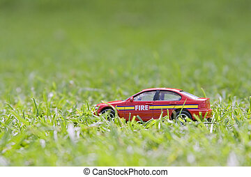 Fire car - A childs small red fire car discarded in the...