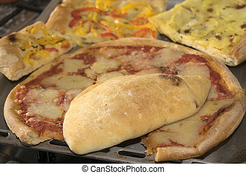 pizza and calzone a Neapolitan pizza roll stuffed with...