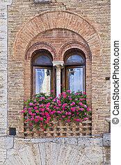 San Gimignano - Colorful houses taken on San Gimignano,...