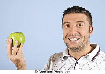 Man with green apple