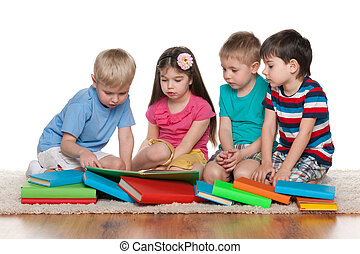 Little children with books on the floor