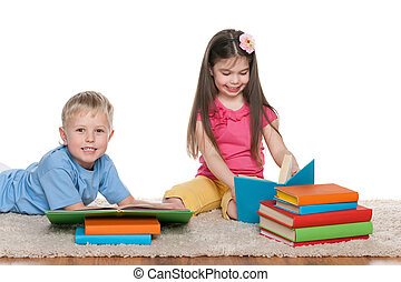 Children with books on the floor